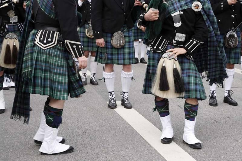 celtic dancers wearing kilts at a festival