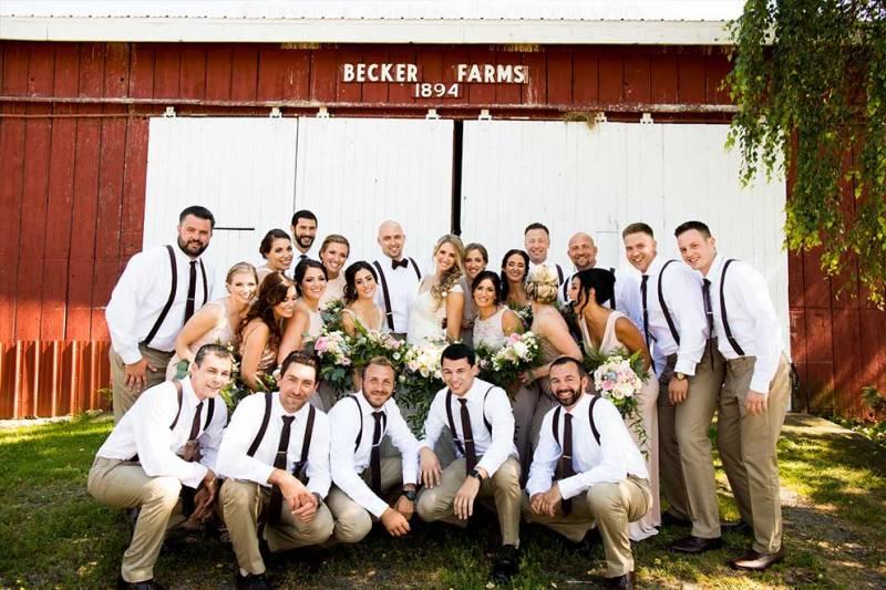 group wedding photo outside becker farms barn at niagara falls