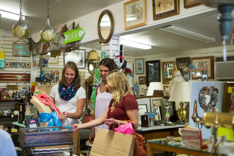 Group of women shopping at antique shop.